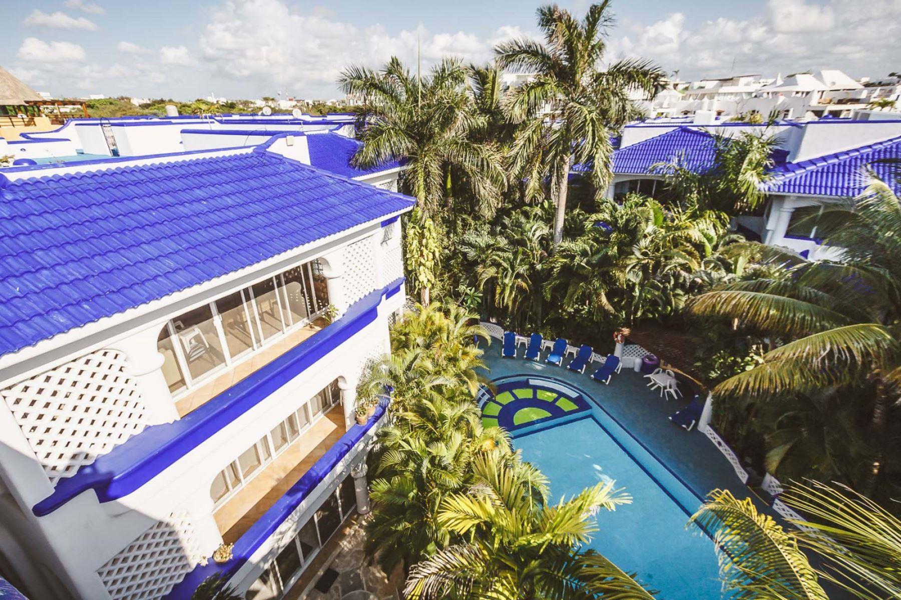 Natz Ti Ha Common Area Pool with Lounge Chairs
