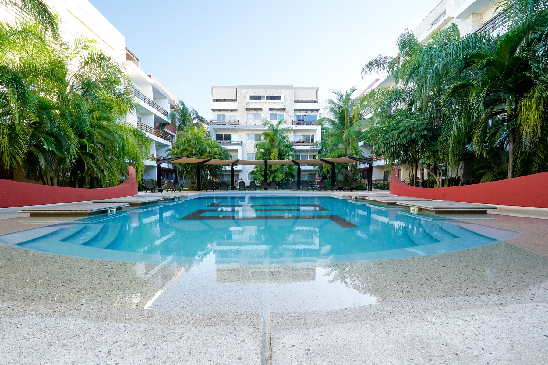 The Sabbia Condos common area pool with lounge chairs